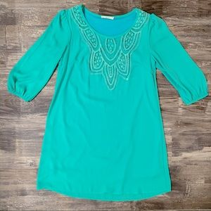 Turquoise dress with embroidery details
